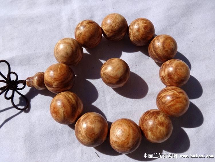 精美长白山琥珀木樱瘤手串